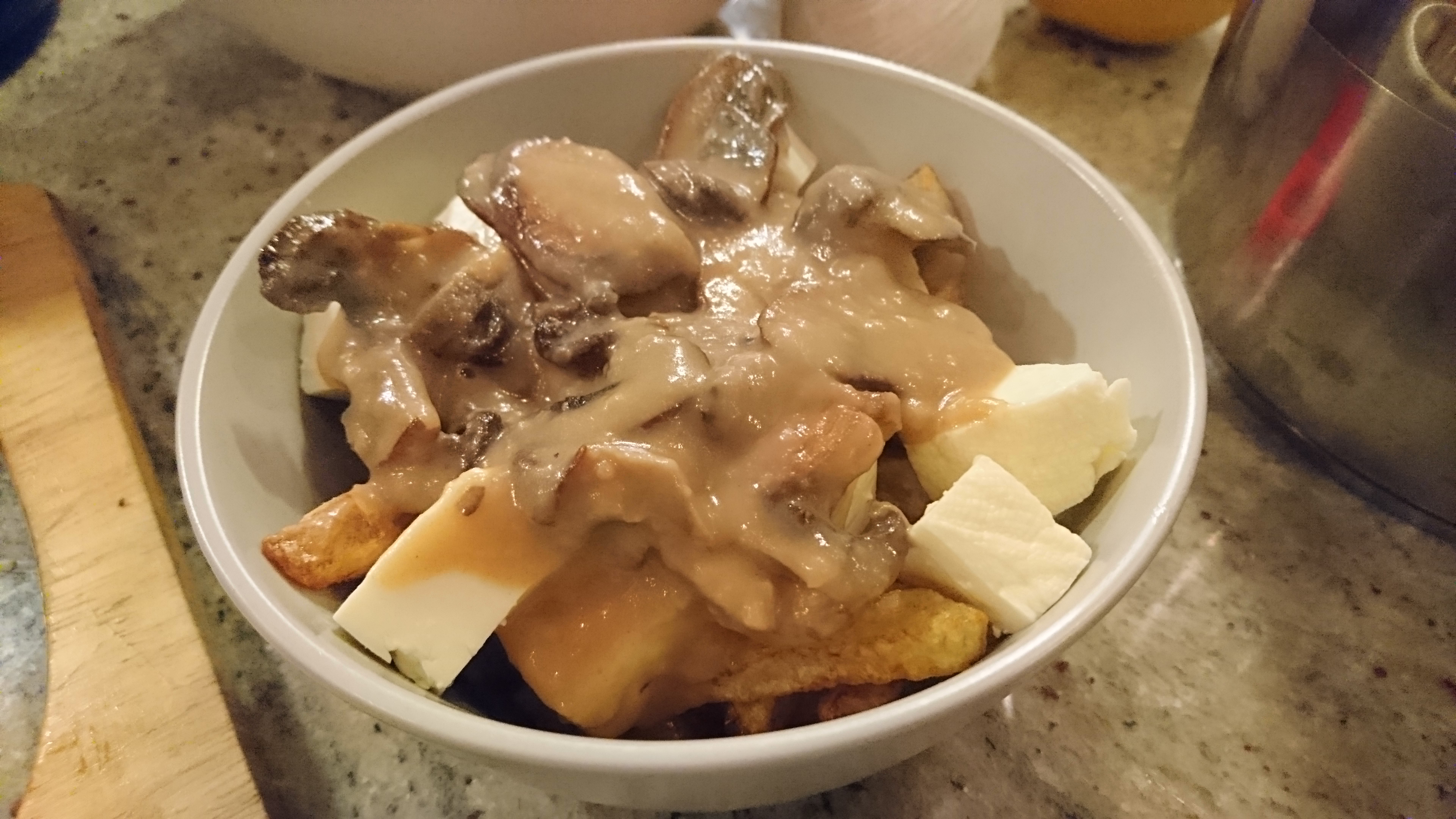 a bowl of homemade poutine