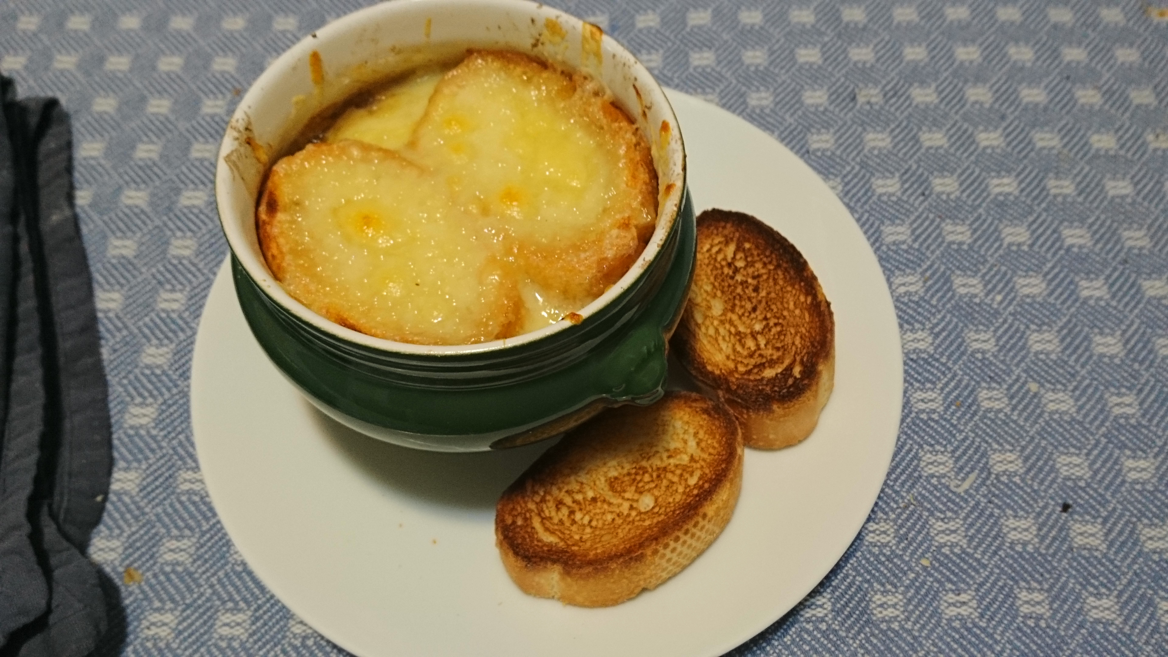 bowl of french onion soup with toasts