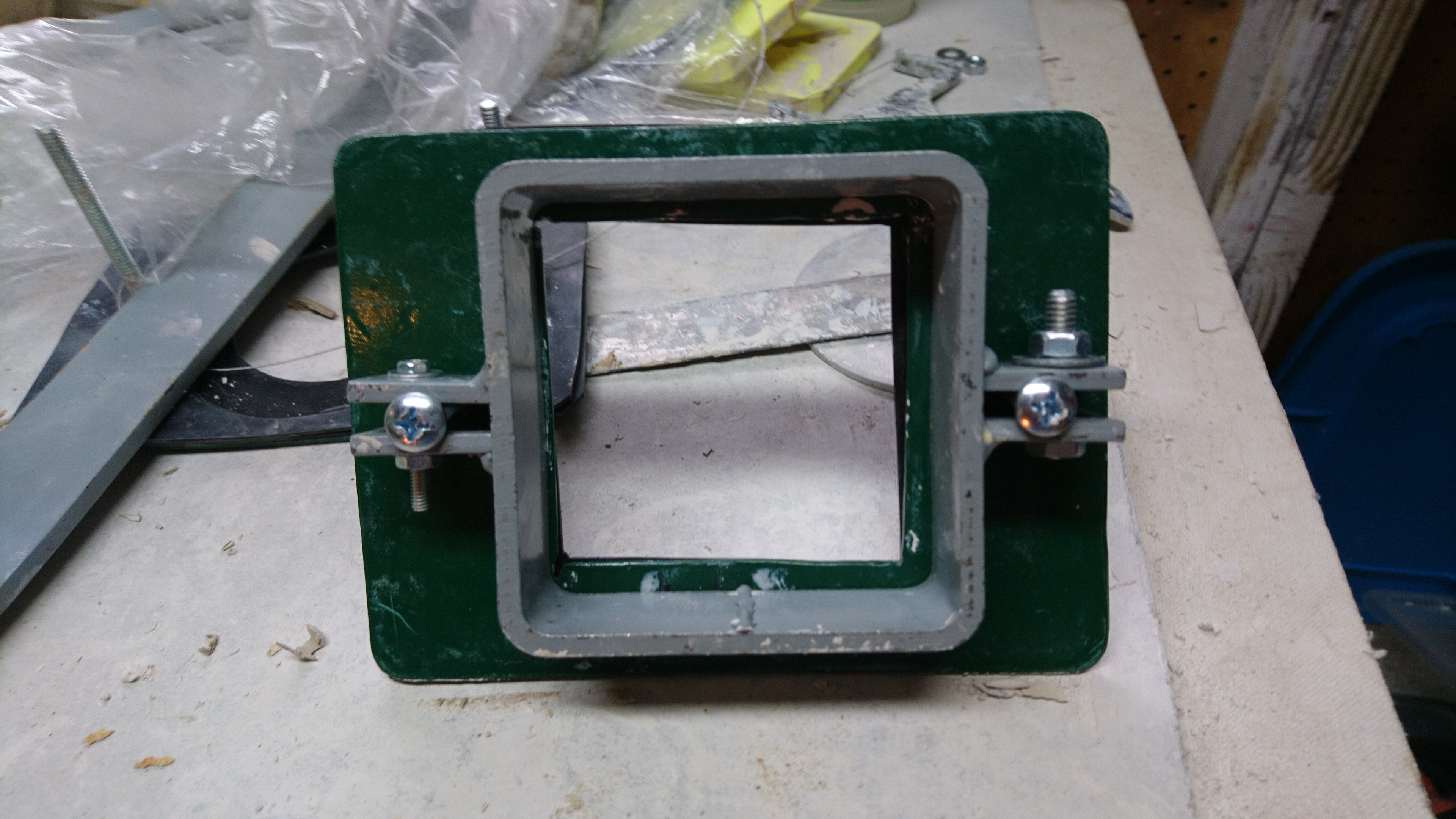 extruder bottom assembly with metal retaining plate